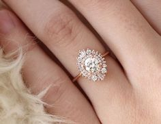 Waterfall Cambria Ring in Rose Gold with white sapphires and moissonite center