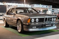 Times were a bit different during the 1983 IAA Frankfurt Motor Show. Where manufactures exhibits spawned grass turf and tan blankets for their displays. In a period where Automotive photographers… Bmw M6 Coupe, Bmw E24, Triumph Bonneville, Ford Gt, Audi Tt, Honda Cb, Street Tracker, Peugeot, Bmw 635 Csi