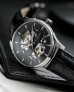 Precision and beauty are on display in the Jazzmaster Skeleton. Hamilton's bold design signature is integrated into a cut-out dial that reveals the highly technical internal mechanics of this captivating and unique timepiece.