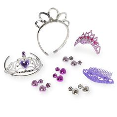 Help your little one get glamorous with the Dream Dazzlers Deluxe Tiara Tote, which comes with 8 different sets of earrings and tiaras to mix and match. <br><br>The Dream Dazzlers Deluxe Tiara Tote Features:<br><ul><li>Includes 4 tiaras and 4 pairs of earrings in a reusable tote</li><br><li>Perfect addition to any dress-up wardrobe</li><br><li>Sequins and gems add shine</li><br><li>Made from durable plastic</li></ul><br><br><br><br>Spark Imagination! Transform ordinary playtime into an…
