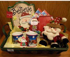 Santa Basket has mugs, stuffed Santa, photo holder, wall decor, napkins and picture frame.