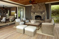 Maximizing indoor and outdoor living by using folding glass doors to minimize the division between the two spaces.