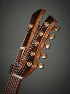 Matsuda peg head. The low E string has an extension that allows it to be played a whole-step lower. So you get the dropped D without having to relax the string. And that should be good for the volume. It has a built-in capo for standard length.