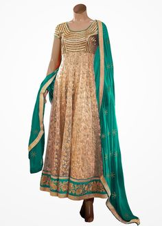 Embrace the #beauty in you donning this #Lovely Beige and Green Colour Net #Suit. >> #Heroine #ColourCarnival #Suits @ Manndola.com
