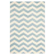Wool rug with a blue chevron motif. Hand-tufted in India.  Product: RugConstruction Material: WoolColor: Blue and ivoryFeatures:  Made in IndiaHand-tufted  Note: Please be aware that actual colors may vary from those shown on your screen. Accent rugs may also not show the entire pattern that the corresponding area rugs have.  Cleaning and Care: Professional cleaning recommended