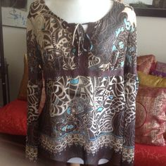 Beautiful Full Figured Women Blouse. Sheer blouse with colors of browns beige and turquoise. Like new used once only. Size XXL Xhilaration Tops Blouses