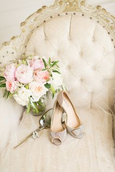 Fluffy pink peony + rose bouquet: Photography : Maison Meredith | Photography : Maison Meredith Photography Read More on SMP: http://www.stylemepretty.com/wisconsin-weddings/arena-wisconsin/2016/06/08/even-rain-couldnt-ruin-this-pretty-pink-wedding/