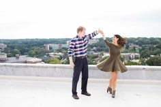 Dancing on a rooftop with your favorite city in the background: Must have shot for my engagement photos one day!! Athens, GA Classic City