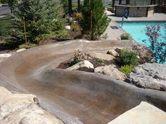 Gunite water slide into a swimming pool