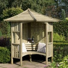 Blooma Solway Wooden Corner Arbour -  British but would look very cute in the front.