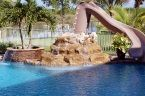 Slides make great additions to your #swimmingpool! This example has two waterfall features as well.