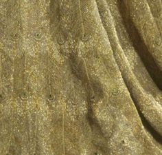 Designed by The House of Worth for Lady Curzon in 1903 (Lord Curzon was the Viceroy of India at the time), the dress was embroidered with gold thread and beetle's wings.