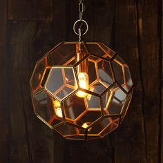 If we told you why this football shaped pendant was called the Moore, you might be more (or less) inclined to hang it.... It's a very classy light.....back o' the net!