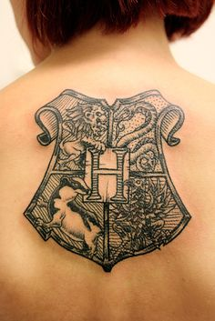 "Harry Potter ~ Hogwarts crest. {""This is my first tattoo, made by the amazing tattoo artist Henrik Gallon at Gallon Tattoo in Stockholm, Sweden. It is the Hogwarts crest from the Harry Potter books, and I love it very much.""}"