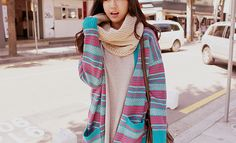 Cute blue and pink patterned knit cardigan.