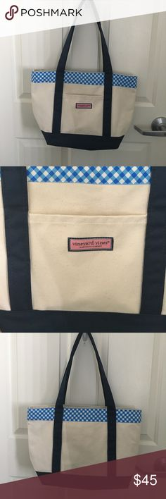 """Vineyard vines canvas tote Vineyard vines classic canvas tote. In great condition, light blue mark on the back from ribbon on my jeans haven't tried to get out but very faint. Other than that like new condition. Fits MacBook Air 13"""" was using as my laptop bag, perfect preppy school bag or weekender Vineyard Vines Bags Totes"""
