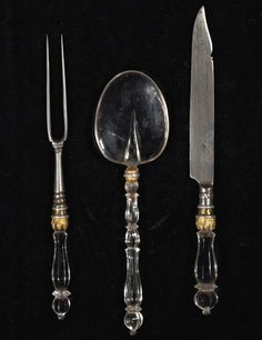 Rock crystal handles ornament this German place setting, which was created in the 17th century, probably in Augsburg. Estimate: $13,000–$19,500.