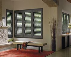 Classic grey plantation shutters by Hunter Douglas - Heritance Collection blend seamlessly into the window openings. Wood shutters allow you to set the wood slats where you want them for everyday use - giving you the privacy or natural light you need for each area. We have the complete line of Hunter Douglas window coverings in our Denver showroom.