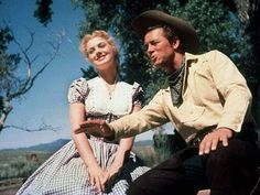 is a 1955 musical film based on the 1943 musical play Oklahoma!, written by composer Richard Rodgers and lyricist/librettist Oscar Hammerstein II and starring Gordon MacRae and Shirley Jones (in her film debut) Old Movies, Great Movies, Oklahoma Musical, Movie Stars, Movie Tv, Shirley Jones, Oklahoma State University, Oklahoma City Thunder, Oklahoma Flag