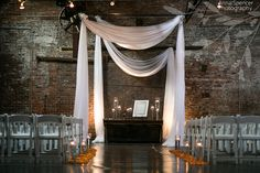 Anna and Spencer Photography, Atlanta Documentary Wedding Photographers. Wedding Ceremony Chuppah at King Plow in Atlanta. Industrial style wedding ceremony venue.