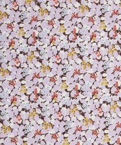 The Hedgerows print by Liberty Fabrics features a dense array of tiny blooms and shapely leaves.