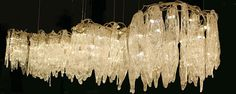 GLAMOROUS LIGHTING  A breath-taking collection of Icicles and Cascade wall and ceiling lights.  Available in a combination of sizes and finishes.
