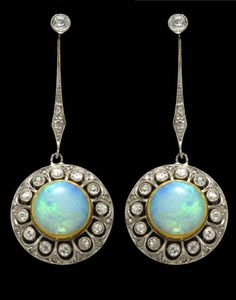 A pair of belle époque opal, diamond, platinum and eighteen karat gold screwback earrings, circa 1915 length: 1 3/4in. (screwbacks of a later date)