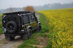 Black Land Rover Defender. High mounted rear lights.