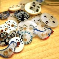 Homemade buttons from #6 plastic (aka shrinky dinks). -Lilyheart