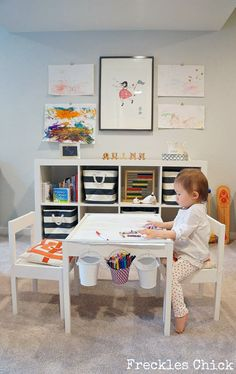 I love this art table and the neat storage idea. Really want to get Isla something like this for Christmas...