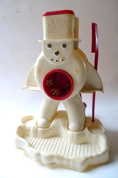 My sister had one of these    vintage frosty sno man snow cone machine toy 1960s hasbro retro toy. $50.00, via Etsy.