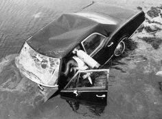 Ted Kennedy's car containing the body of Mary Joe Kopechne pulled out of Chappaquiddick tidal channel after he drove it off the bridge and left her to drown. 1969