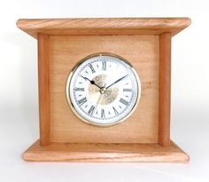 $35.00 - This Rustic Wood Clock is handcrafted from pallet wood, then stained and sealed with cherry tinted Danish Oil. Due to having been created from pallets, the wood does have the nail holes and other imperfections that give it its rustic charm. Yet, its simple and stylish design makes it a perfect fit with just about any rustic, primitive, or traditional decor... Click on the image above for more information or to buy from WileWood. Thank you for your interest!