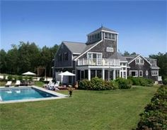 """Beachside"" overlooks the tranquility of Little Harbor, and its world class fishing, birding, and boating. It also has private access to Sandy Beach and Secret Cove, and its own private mineral springs pool. The Nantucket Shingle-style home has decks and screened porches that allow for true indoor/outdoor entertaining. Additional features include a kitchen with local custom cabinetry and maritime details, a master suite with an elevated ""sunrise"" deck, and a third-story tower with 360° view."