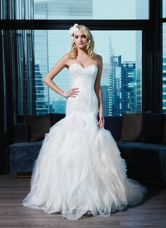 Justin Alexander Signature Wedding Dress Style 9769 Tulle, cotton lace, sequins fit and flare dress complemented with a sweetheart neckline.