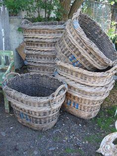 Wonderful antique baskets with blue monograms.