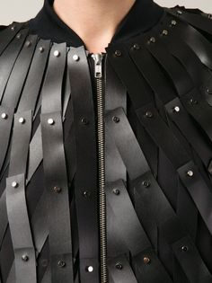 Fabric Manipulation - woven leather jacket with riveted strips; close up fashion detail // Noir Kei Ninomiya