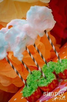 Lorax party: Plant a seed activity, cotton candy truffula trees on cake (JoJo liked the Lorax and requested cotton candy on her cake, so maybe)