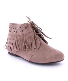 Studs and wraparound fringe add boho style to this city-chic ankle boot.