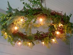 Grapevine Wreath Chandelier...cute idea for a patio or porch.