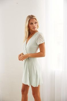 Hey babe, meet the Valerie Wrap Mini Dress! This adorable piece features a V neckline, a classic wrap design with an adjustable tie, and a glimmery mesh material. Available in mint green. Add on the Yarra Strappy Block Heel for a sweet elegant look! Tie Dress, V Neck Dress, Wrap Dress, Gold Shimmer Dress, Sorority Rush, Strappy Block Heels, Mesh Material, Green Dress, Mint Green