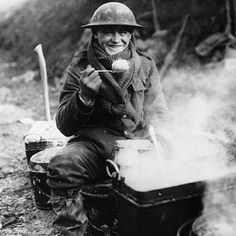 The Most Powerful Images Of World War I  A smiling soldier sitting in the mud near the western front, eating a spoonful of hot food. This would appear to be one of a series of official photographs showing the soldiers' rations, possibly intended to reassure their families at home
