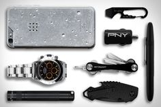 Posh Projects x Realize Luna iPhone Skin ($30). Kershaw Shuffle Multi-Function Knife ($20). Rolex SS Zenith Daytona Watch ($13,500). Maglite Solitaire Flashlight ($13). Niteize DoohicKey ($5). PNY Mini USB Car Charger ($10). KeySmart Key Holder ($20). Fisher Space Pen (18)....