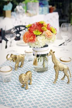 Cheap, yet chic baby shower decor - get the plastic animal pack from the craft store and spray paint gold. Perfect for a posh safari-themed shower!