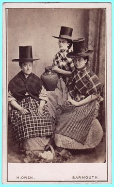 19th century Welsh women in typical Welsh clothing... Ginghams, plaids, stripes and wild hats....