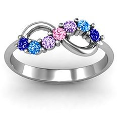 this is my ring!!!  Sapphire, blue topaz, amethyst for the girls months and pink tourmaline for our wedding month