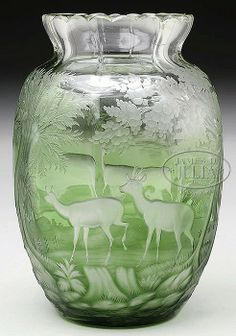 Very fine Bohemian heavy green cut-to-clear glass vase with woodland scene and four deer, prob. by Moser
