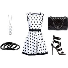 Love this polka dot sleeveless dress.  Don't own a white dress. Nice simple silver necklace as well.