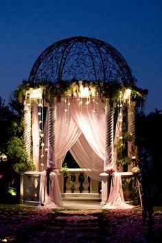 Gazebo with fabric draping & lighting – such structures inspire wedding photographs and create settings for other intimate moments