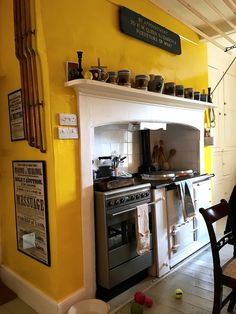 Cracking The Ben Pentreath Paint Colors Mystery - laurel home - Ben's charming kitchen in Dorset painted a saturated egg yolk yellow. This image was taken by me when I was lucky enough to have lunch in his extraordinary home and gardens in October 2017.